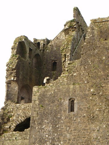 The cathedral on the Rock of Cashel. The missing corner has fallen off and is on the lawn.