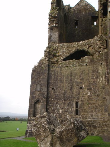 Outside the cathedral on the Rock of Cashel. Part of the wall where is fell