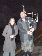 Em and the Bag-piper we met on our way home. He kindly played us a tune to make up for no other pipers that night. : by milko_rosie, Views[747]