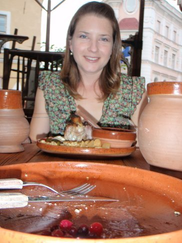 Em and her dinner at the medieval restaraunt. The clay mugs either side are the beer mugs.