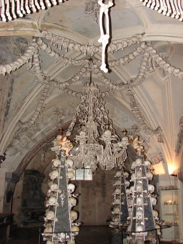 Inside the Kutna Hora church where all of the bones are. In the centre of this picture is a chandilier.