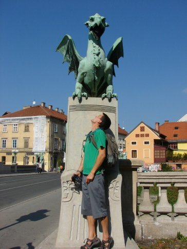 Maneesh with one of the dragons on a famous bridge in Ljubljana.