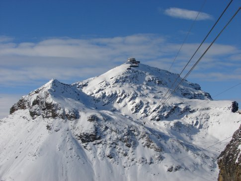 Up the Schilthorn Cablecar. The revolving restaraunt is in the distance.