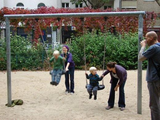 Em with Tina and the two boys playing on the swings in a nice little playground near our apartment.