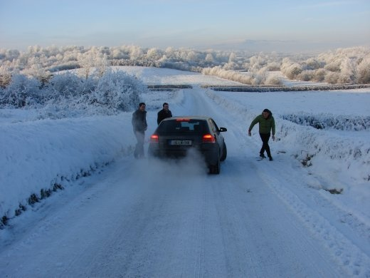 Trying to get the car up a hill on the way home from Christmas mass, it needed some extra help on the slippery slope.