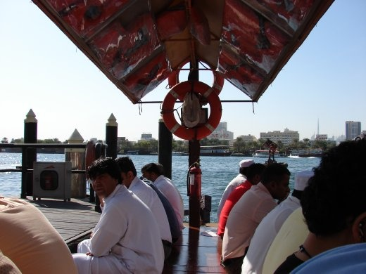 On the Abra, heading across the river to the Grand Souk.