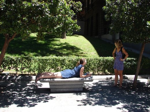 Em taking advantage of a bench in Madrid to do some back exercises.