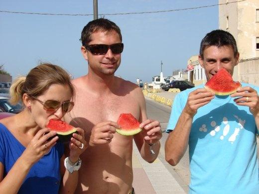 A morning tea in Tarifa. Julie, James and Maneesh enjoying delicious watermelon.