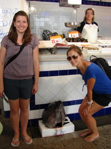 Em and Julz with a Tuna head at the fish market in Tarifa.