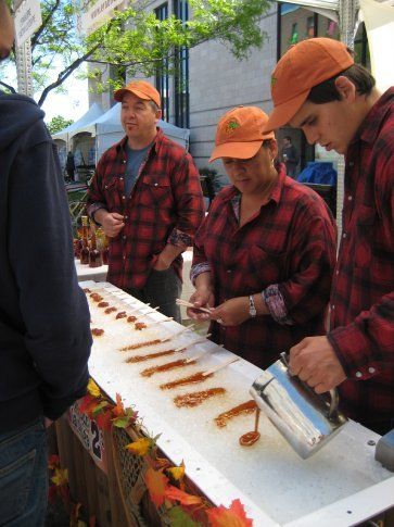 Maple Taffy. Made by pouring hot maple syrup on 'snow' and rolling it onto a stick.