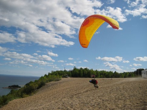 Jumping off the dunes.