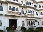Our beautiful lakeside heritage hotel in Udaipur. Anna is standing in the entrance -- our room is the mirror image of the one to the immediate right on the ground floor ( it would be on the left). Lovely cushioned window seat for lounging and looking out at the garden and lake. : by mlodius, Views[79]