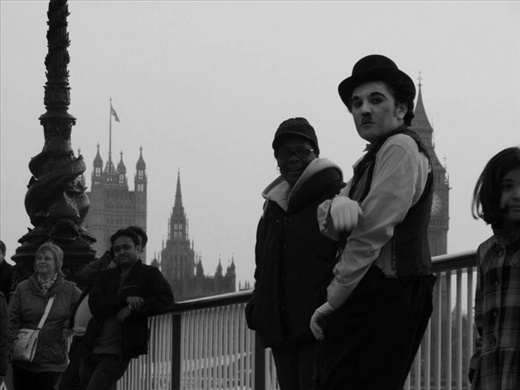 The Late Charlie Chapman: The Charlie Chapman character in this photograph exemplifies the old-fashioned and traditional qualities which are emitted throughout the entirety of London. The street performer looking directly at my camera and standing with Big Ben and Parliament in the background makes for a very simple and wholesome depiction of this historical city.