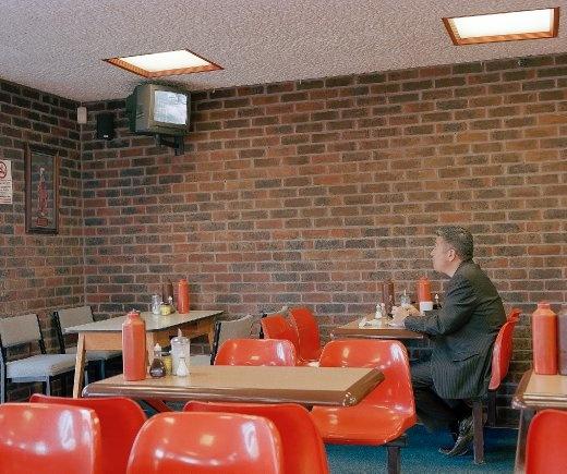 A man watching a cctv monitor.