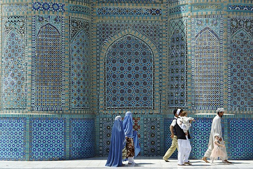 An entire Muslim family attending the weekly Friday prayers at the Blue Mosque in Mazar-e Sharif.  Although Taliban laws dictating that women must mandatorily wear the characteristic chadri in public are no longer enforced, women still continue to wear it. Similarly, women can easily be spotten walking behind the husband, just like it was required by the Taliban - back then with a strict rule of no less than 5 meter behind the man.