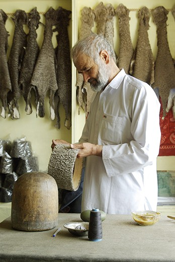 Local hatter crafts the traditional Qaraqul hat, made from the fur of an endemic breed of sheep, in Kabul.