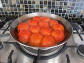 Place each of the tomatoes facing down and let them simmer over a low fire.: by monicalovestravel, Views[178]