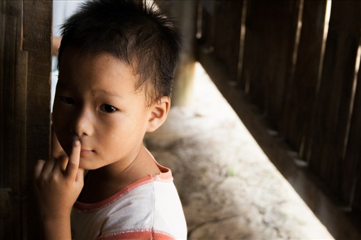 I'm probably one of the first foreigners that this young Burmese refugee has seen in his life.