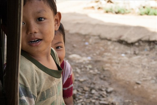 Hide and Seek with a camera. Whenever these two young refugees saw the camera they sprinted away at top speed, but inevitably sneaked back to view every photograph.