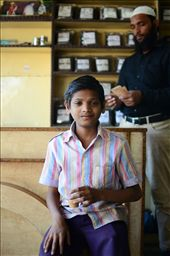 A young boy drinks chai masala while his father counts his days earnings.: by moosey84, Views[88]