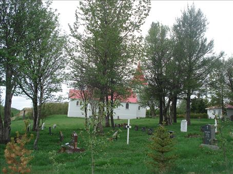 A shot of the church and graveyard (the only time the church gets used).