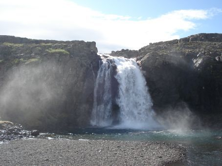 Foss means falls in Icelandic. So waterfalls have the -foss suffix: Dettifoss, Selfoss, etc. This one was just called Foss.