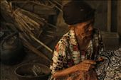 An old woman diligently paints batik patterns on cloth in a half built house in the village of Bantul, DIY. She earns five $2-5 for each batik cloth, which is then sold to the middleman who sells it to public markets and foreigners for $30-50.: by msromilab, Views[437]
