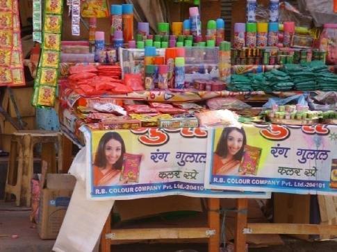 Delhi. Vending stall set up for holi celebration.