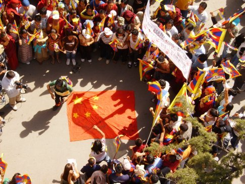 Protestors prepare to trample on a Chinese flag, in support of Tibetan rights, Mcleod ganj, March 2008.