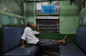 A thinking man on Mumbai local train. At peace in the cacophonous surrounding.: by mumbai_matinee, Views[495]