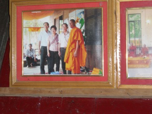 Picture of my parents at the temple where they donated money