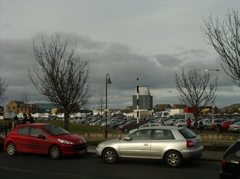 The main st of Howth, with the little food market in the backgound
