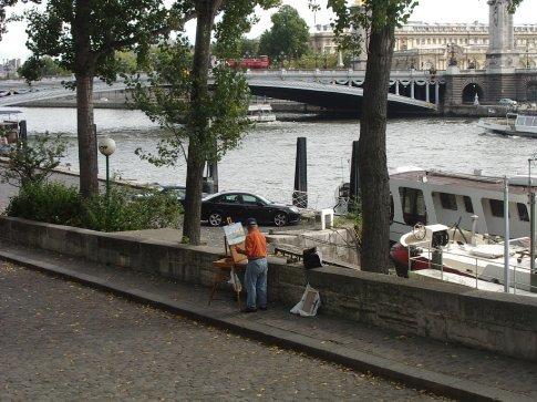 An artist painting Paris