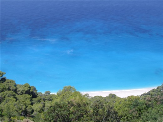 sparkling blue waters, golden sand and nature all around. a place like heaven...