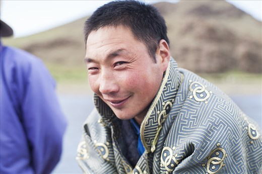 A portrait of a local Mongolian man who helped crossing the river