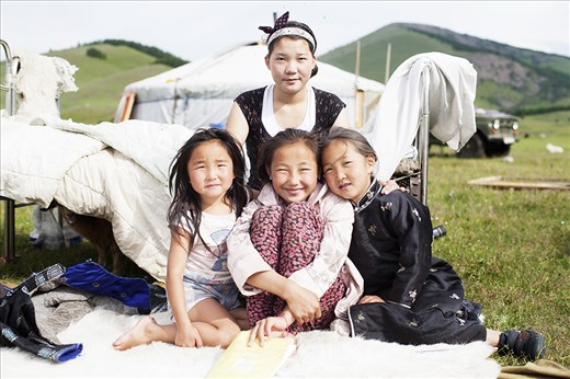Three girls from two different families that host travellers