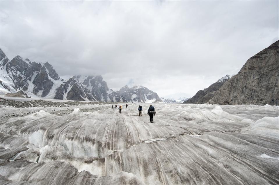 Trekking across black ice on the biafo glacier on route to Hisper La Pass.