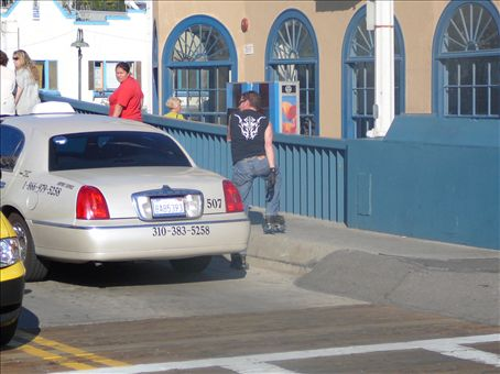 Taxis don't like rollerbladers trying to get a free ride from the bottom of the ramp.