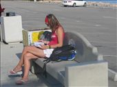 Reading the lonely planet waiting for a bus, she better get use to this.: by nat_and_chris, Views[348]