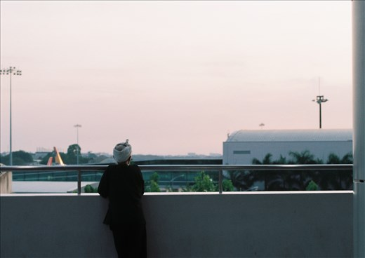 An old man at the airport watching sunset, by 35mm film
