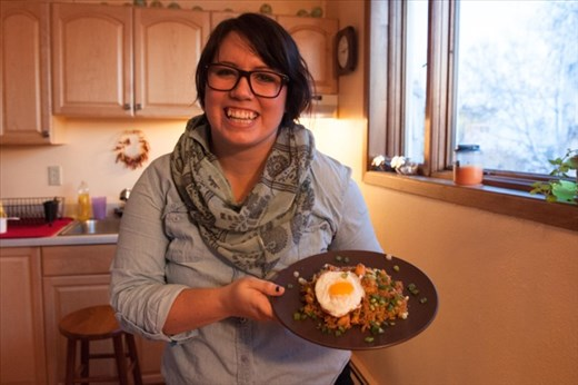 Me showing off a finished plate of nasi goreng, complete with fried egg