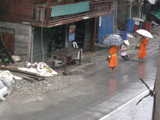 Monks collecting alms in Pak Beng