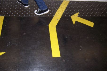 obviously a dumb quartier, since they felt the need to paint instructions on how to get on the metro on the ground. walk this way. reallly?>???