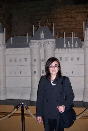 me in front of a model of the ancien louvre