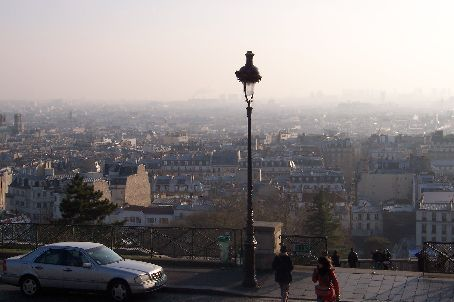 sitting on the steps of sacre-coeur listening to a busker with a microphone - the view