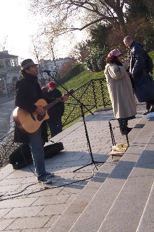 sitting on the steps of sacre-coeur listening to a busker with a microphone