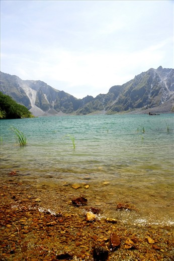 After an hour of walking in the desert, and an extra 30 minutes of climbing to the top, Pinatubo welcomes trekkers with this vision. The crater contains highly mineralized water, and due to the water's sulfur content, there is a distinct yellow discoloration of the rocks that blends with the blue color of the lake. It is unbelievable that this was once the mouth that spewed chaos in the northern part of the archipelago, and changed hundreds of Filipinos' lives forever.