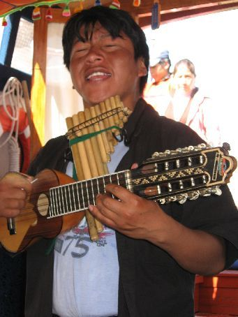 A musician that entertained us on the boat to the islands on Lake titicaca. He was excellent!