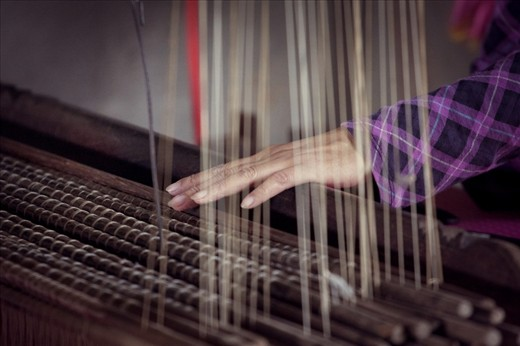 The delicate work of the silk weaver.