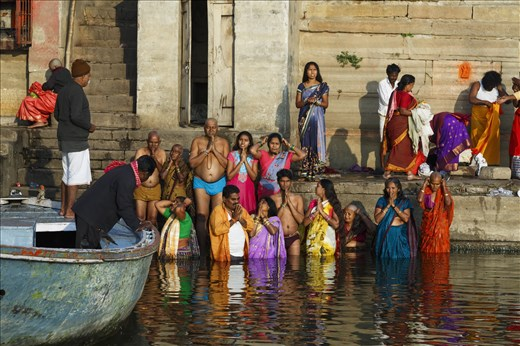 Devotees offering prayers to the Sun God after taking a dip in the holy Ganga
